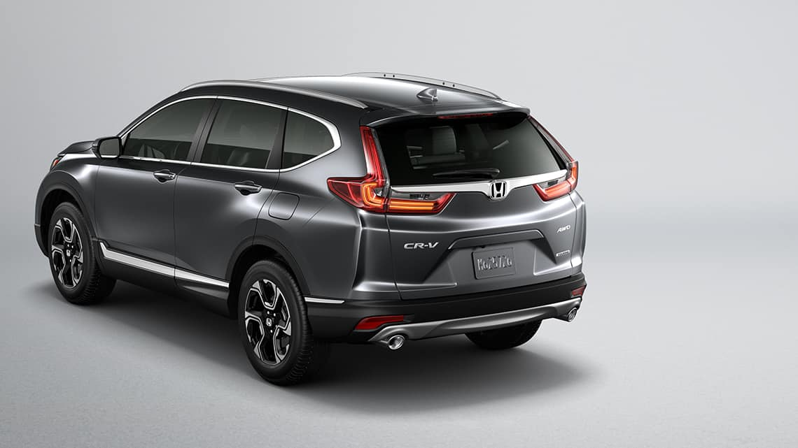 Rear 3/4 view of 2019 Honda CR-V Touring in Gunmetal Metallic showing LED taillights.