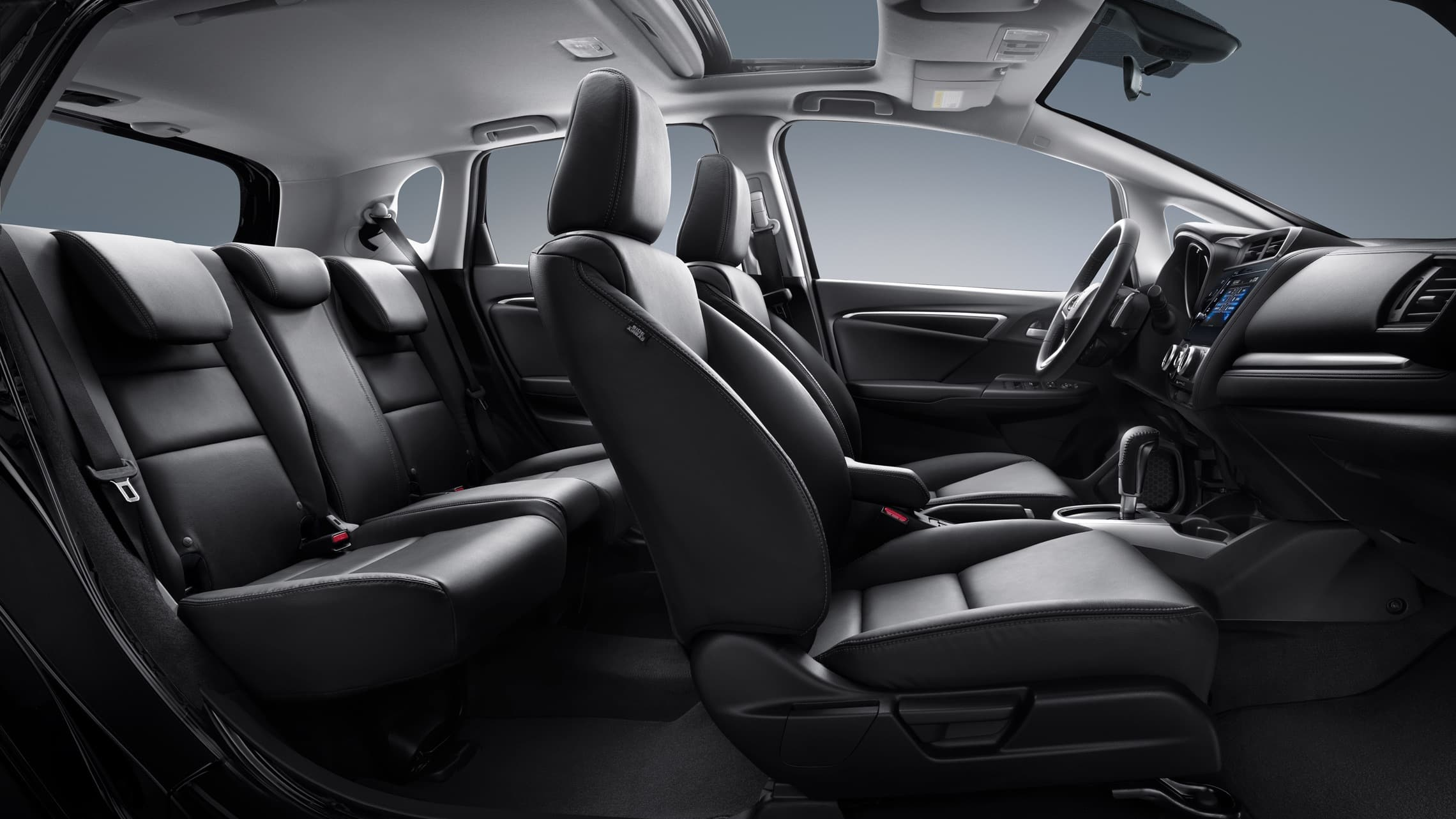 Interior passenger-side profile view of the 2020 Honda Fit EX-L with Black Leather.