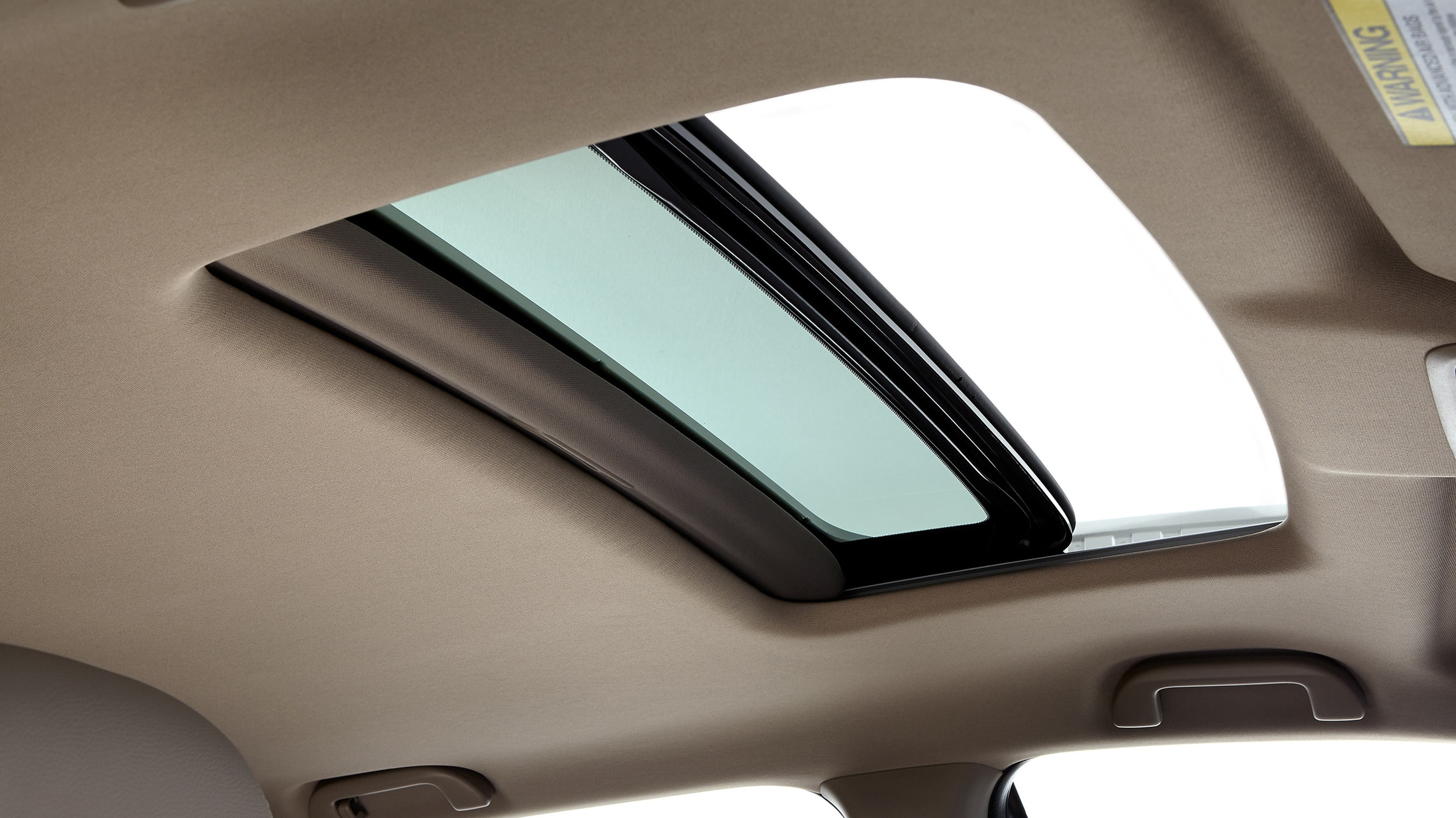 One-touch power moonroof detail on 2021 Honda Pilot EX-L with Beige Leather.
